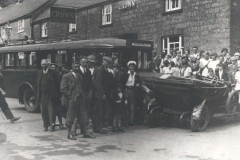 000040 Crash between a bus and car outside the Crown Inn with a crowd gathered around date unknown