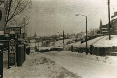 003894 Looking west in Butts road from Marshalsea's filling station showing the pumps and a snow covered scene 1963