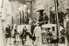 000110 Childrens carnival, Ilminster (note Hurlstones petrol pumps) c1930