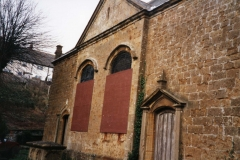 002494 View of the front of the building from the south west corner of the Unitarian Chapel showing the two front doors 1992