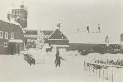 000178 Court Barton in the snow showing railings around the Green 1895