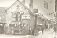 000158  Swan Hotel showing Ditton Street decorated for Silver Jubilee of King George V 1935