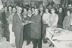 000304 Hector Hutchings, Chairman of Minsterstone receiving retirement gift from Charles White 1980