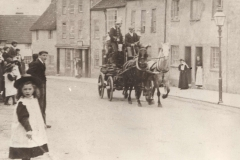 000045 Fire Brigade responding in West Street, Ilminster showing onlookers and the horse drawn fire engine 1914