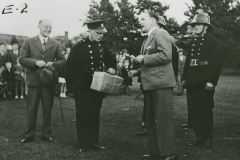002431 H F Bartle, Chairman of the Council, making an award to fireman at Ilminster 'At Home' event 1939