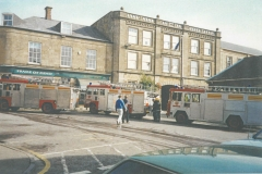 003870 Firemen dealing with a fire in Cornhill factory, Ilminster c2002