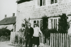 003149 People outside a cottage c1920