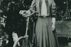 000681 Eva standing next to a  bicycle c1907