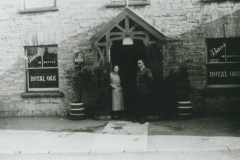 003071 Royal Oak Inn showing Sgt Maurice Coombs and Annie Taylor standing at the enterance1937