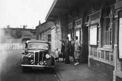 002862 Ilminster railway station featuring a number of people waiting outside 1951
