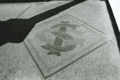 003085 Ilminster Grammar School logo in floor of entrance to pavilion in playing field, Ilminster c1980