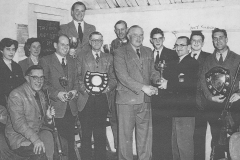 003032 Ilminster Rifle Club with trophies, featuring Anne Carpenter, Edith Sawyer, Len Riddock, Paddy Graydon, George West, Vernon Carpenter, Bill Spinks, Noel Simpson, R Flexmore, Dick Arney, Bruce Lang c1950