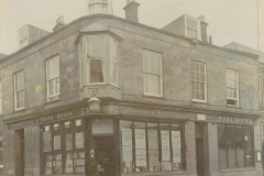 000127 Stationers, news agent and post office on the corner in Market Square showing owner Charles Pope Chapple 1903