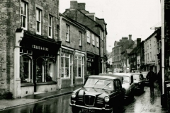000086 Chard and Sons foot ware shop on the left 1966