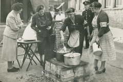 000267 Civil Defence Emergency cooking exercise in Market Square, Ilminster featuring Mrs Crocker, Mrs Samways, Mrs Duke and Mrs M Wilson 1954