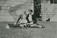 002485 Geoffrey Lodge, Nina Lodge and son Michael, Ilminster showing anti blast wall and window tape 1942