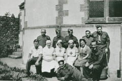 002486 Patients and staff at Red Cross Camp Reception Hospital, Methodist School Rooms, Ilminster showing Mrs Norrington and Jose Duke 1940