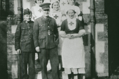 002487 Staff at Red Cross Camp Reception Hospital, Methodist School Rooms, Ilminster featuring Joan Scott, Jose Duke, Evelyn Vickery, Betty Ball, Sgt Graves and Lieut Tait 1939