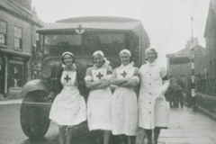 002488 RAMC ambulance and four nurses outside Red Cross Camp Reception Hospital, Methodist School Rooms, Ilminster featuring Joan Scott, Jose Duke, Evelyn Vickery and Betty Ball1940